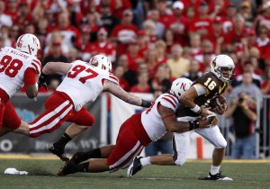 Brett Smith is brought down by the Nebraska defense, the two teams last met in 2011.