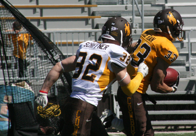 Jake Schiffner chases down Dominic Rufran during the 2012 Brown and White game in Laramie. Jake Schiffner is now headed to the CFL combine in Edmonton, Alberta. (Photo via Richard Anderson/WyomingSports)