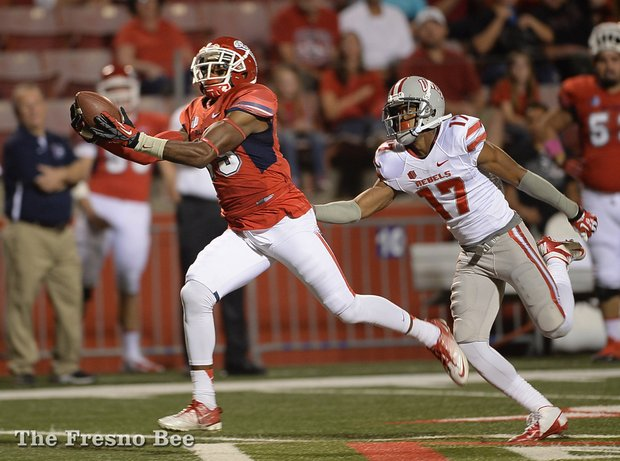 Fresno State wide receiver Devonte Adams catches a Derek Carr pass for a touchdown vs UNLV this past weekend. Fresno State went on to win the game 38-14. (Photo courtesy of Mark Crosse of the Fresno Bee)