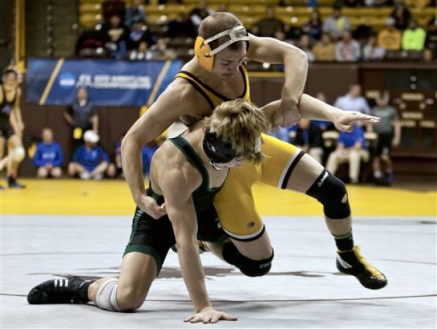 Cowboy wrestler Tyler Cox faces off with Utah Valley State wrestler Val Rauser during the WWC tournament in Laramie. Cox will look to capture All-American status again this season. (Photo courtesy of Jeremy Martin / Laramie Boomerang)