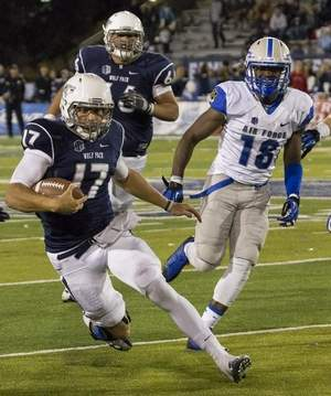 Nevada Wolf Pack quarterback Cody Fajardo rushes for yardage against Air Force last Saturday. The Wolf Pack went on to win 45-42. (Tom Smedes photo/Special to the RGJ)