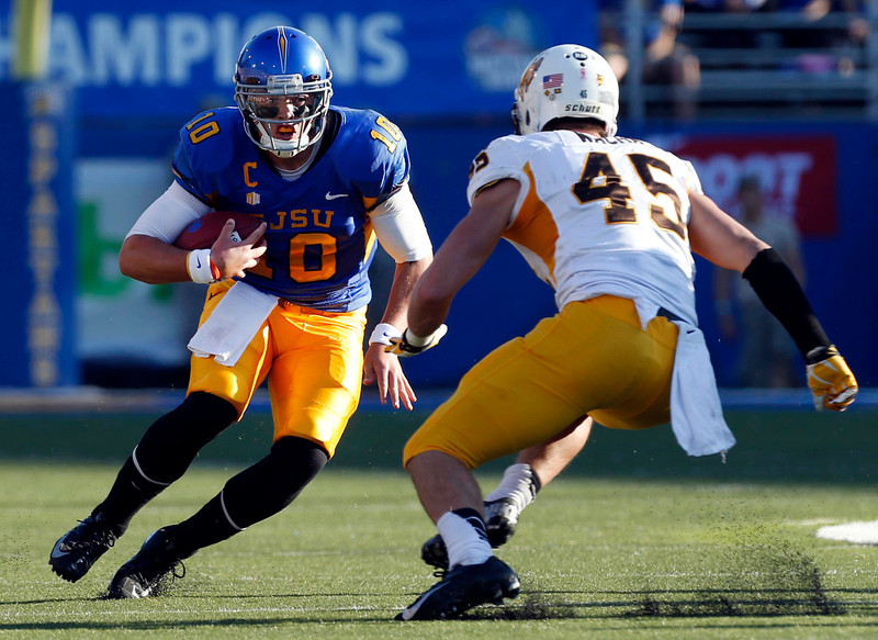 San Jose State Spartan quarterback David Fales is on a rush and stopped by Wyoming linebacker Luke Wacha on Saturday. San Jose State went on to win 51-44. (Karl Mondon/Bay Area News Group)