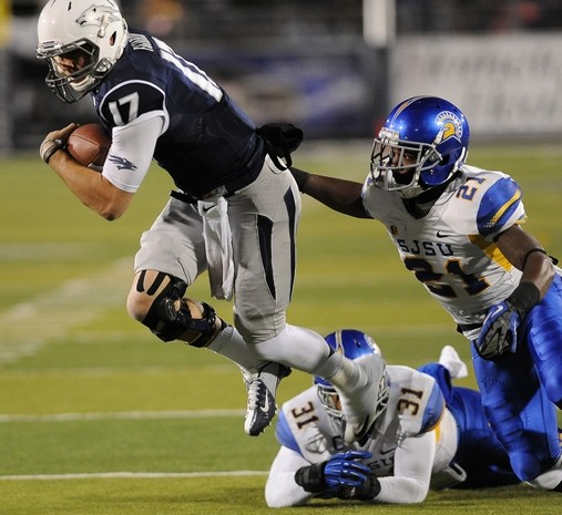 Nevada Wolf Pack quarterback Cody Fajardo escapes a tackle from SJSU's Kevin Smith during last Saturday's game. The Wolf Pack would go on to win 38-16. (Photo via Julie Dawes/RGJ)