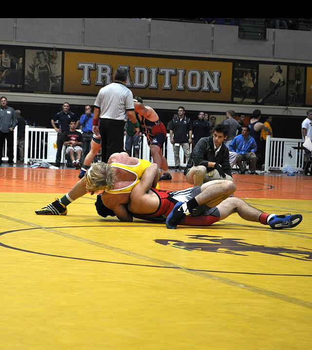 Wyoming's 157 pound junior Andy McCulley goes for a pin recently in the Cowboy Open held in Laramie. (Photo via @WyoWrestle Twitter)