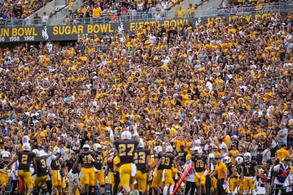 Wyoming celebrates a blocked punt in front of a packed War Memorial Stadium last Saturday.