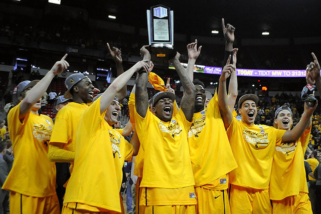 The Cowboys celebrate their Mountain West tournament championship by raising the trophy in front of a large Wyoming crowd. The Pokes will face Northern Iowa in Seattle on Friday morning. (Sam Morris/Las Vegas Review-Journal)