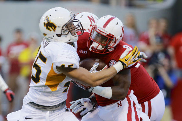 Wyoming linebacker Michael Wacha tackles Nebraska running back Ameer Abdullah in Lincoln. Wacha looks to anchor the linebacker core of the Cowboy defense this season. (Photo via Nati Harnik/Associated Press)