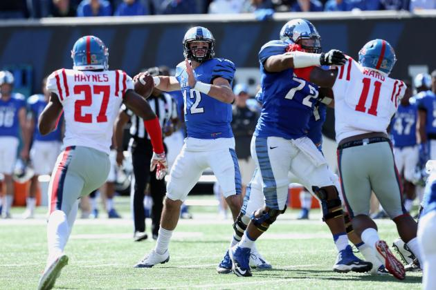 Memphis quarterback Paxton Lynch drops back to pass vs Ole Miss this past weekend. The Tigers went on to win that game against the Rebels 37-24. The Tigers, among other team, are building their case to represent the Group of Five in a New Years day bowl game. (Photo via Joe Murphy/Getty Images)