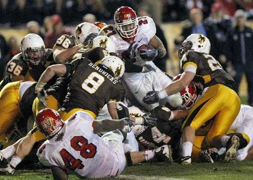 The Wyoming Cowboy defense, led by Chris Prosinski (24) and Mitch Unrein (96) stop Fresno State running back Ryan Mathews at the one yard line to seal up a New Mexico Bowl win in 2009. They will now be teammates for the Chicago Bears. (Photo via media.fresnobee.com)