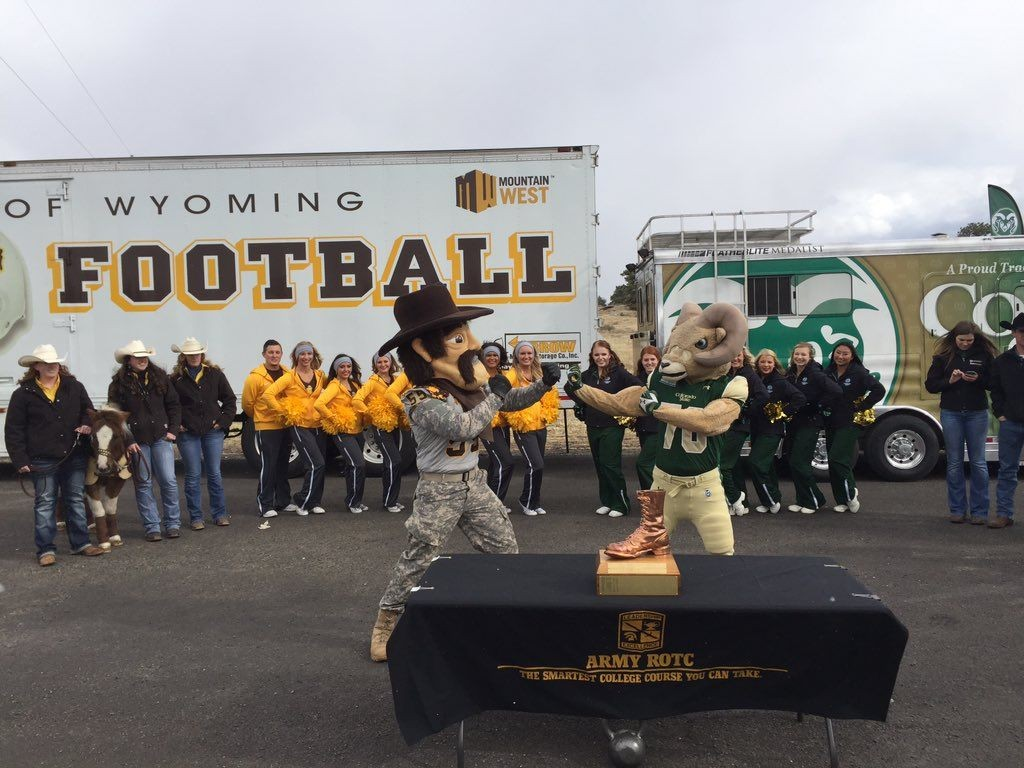 Pistol Pete and Cam the Ram meet at the Wyoming/Colorado border on Friday in the annual passing of the game ball at the border. The two teams met on Saturday for the 107th time in history. (Photo via Wyoming Athletics)