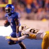 Boise State Broncos wide receiver Shane Williams-Rhodes (1) attempts to elude Wyoming Cowboys safety Andrew Wingard (28) Photo Credit: Brian Losness-USA TODAY Sports