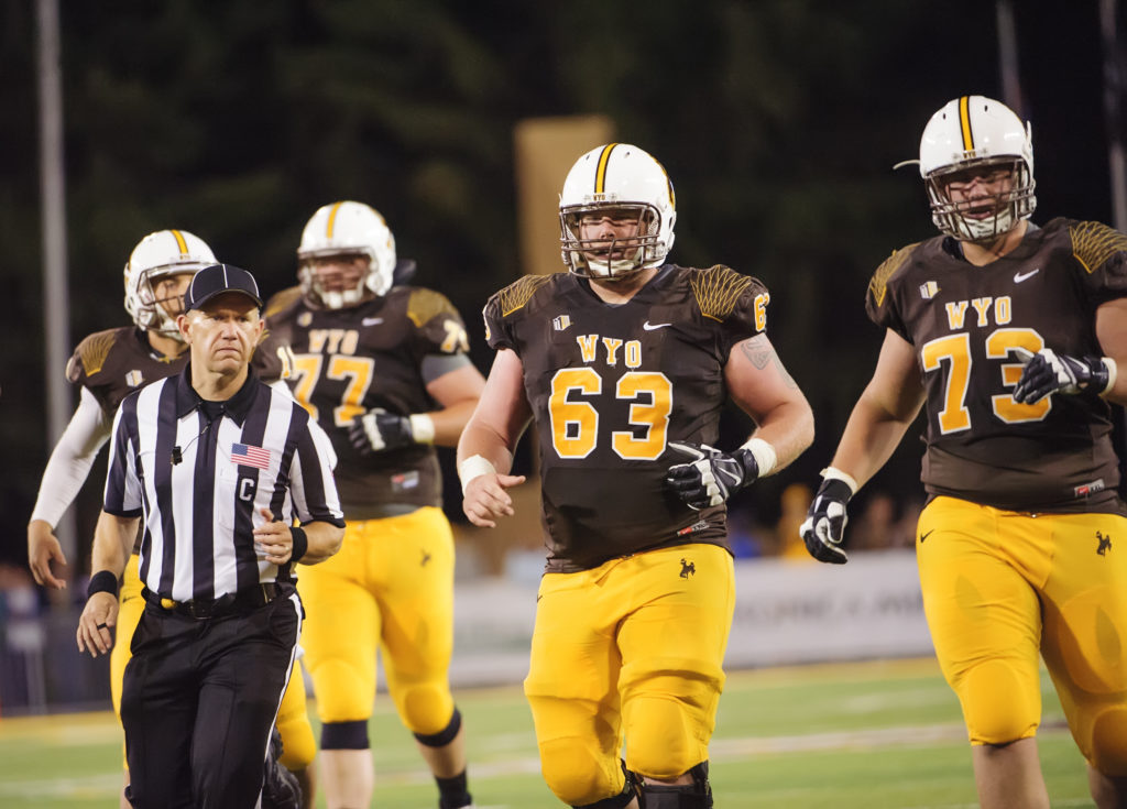 Senior offensive lineman Rafe Kiely will be an important piece to the Wyoming offensive line this coming season. He, along with Chase Roullier, will be relied on being the anchors of the line. (Photo via Wyoming Athletics)