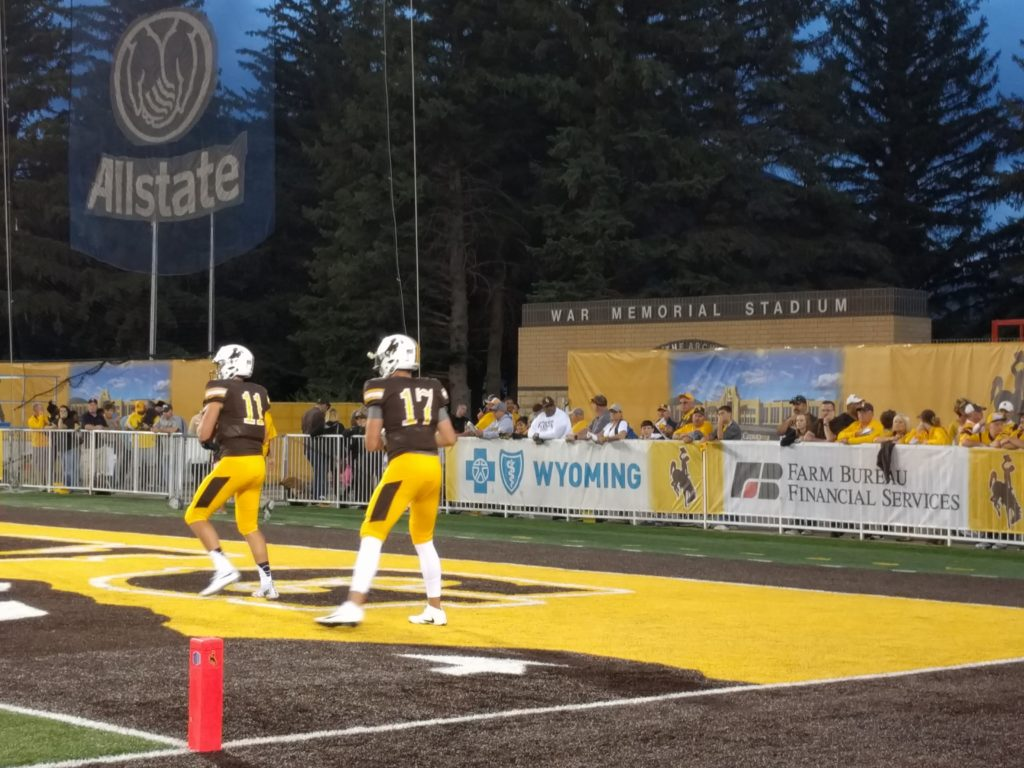 Wyoming quarterback Josh Allen won the game for Wyoming in triple overtime on Saturday night. Allen rushed from seven yards out to beat Northern Illinois 40-34. (Photo via WyoNation.com)