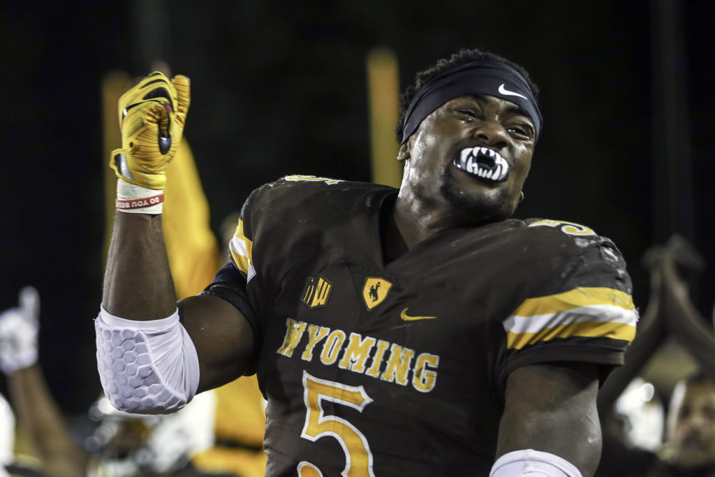 Brian Hill celebrates the safety which clinched the game for the Pokes. Photo Credit: Pete Arnold.