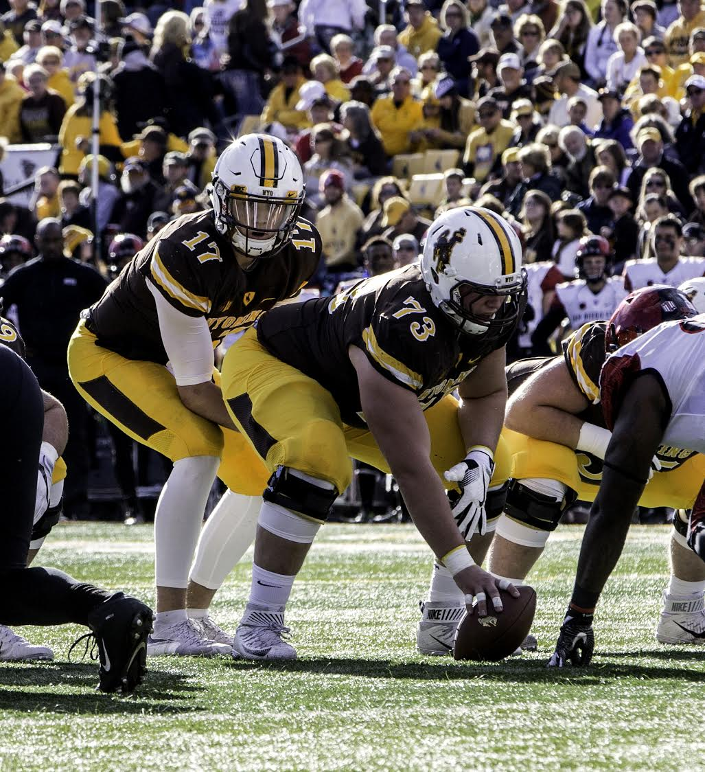 UW redshirt sophomore, Josh Allen rushed for 56 yards and threw for 282 yards and two touchdowns in UW's 34 to 33 victory over SDSU November 19th in Laramie. Photo Credit: Pete Arnold